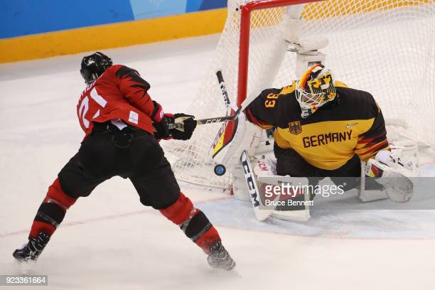Danny Aus Den Birken of Germany makes a save against Mason Raymond of Canada in the second period during the Men's Playoffs Semifinals on day...