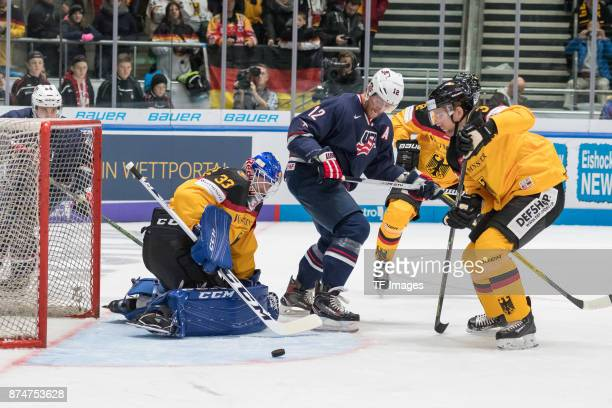 Danny aus den Birken of Germany Ryan Malone of USA Justin Krueger of Germany in action during the Deutschland Cup 2017 match between Germany and USA...