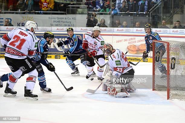 Danny aus den Birken of Koeln stops a goal shot from Jared Ross of Ingolstadt in game six of the DEL final playoffs between ERC Ingolstadt and...