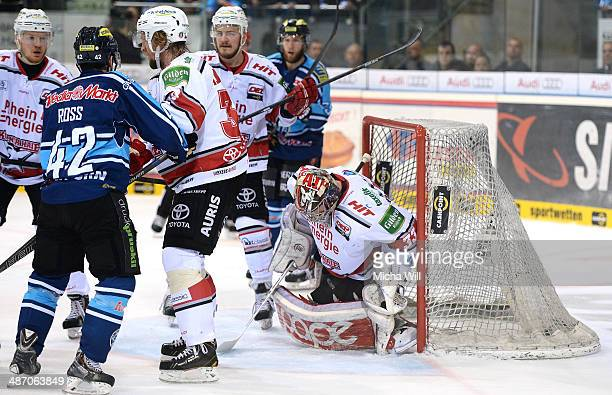 Danny aus den Birken of Koeln stops the puck in game six of the DEL final playoffs between ERC Ingolstadt and Koelner Haie at Saturn Arena on April...