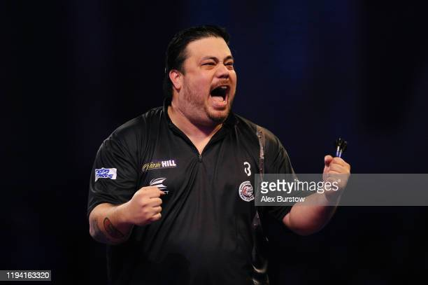 Danny Baggish of The United States celebrates after winning his First Round match against Andy Boulton of England during Day Three of the 2020...