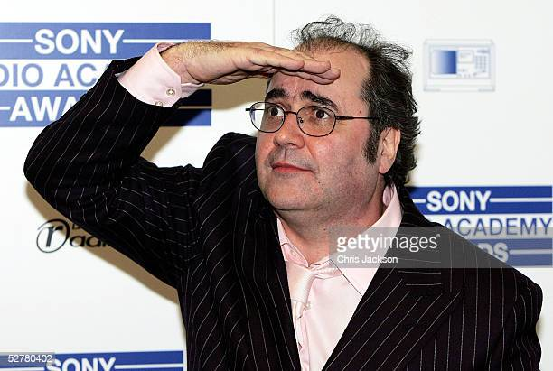 Danny Baker poses in the pressroom with the prize for DJ of the Year at the Sony Radio Academy Awards at Grosvenor House Hotel on May 9 2005 in...