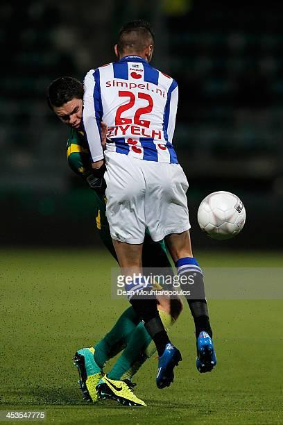 Danny Bakker of ADO and Hakim Ziyech of Heerenveen colide during the Eredivisie match between ADO Den Haag and sc Heerenveen held at Kyocera Stadium...