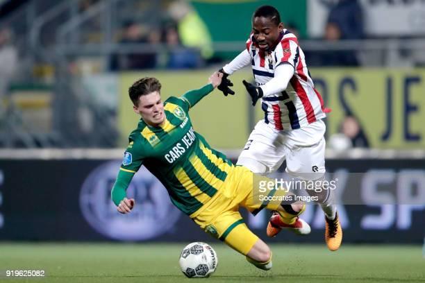 Danny Bakker of ADO Den Haag Eyong Enoh of Willem II during the Dutch Eredivisie match between ADO Den Haag v Willem II at the Cars Jeans Stadium on...