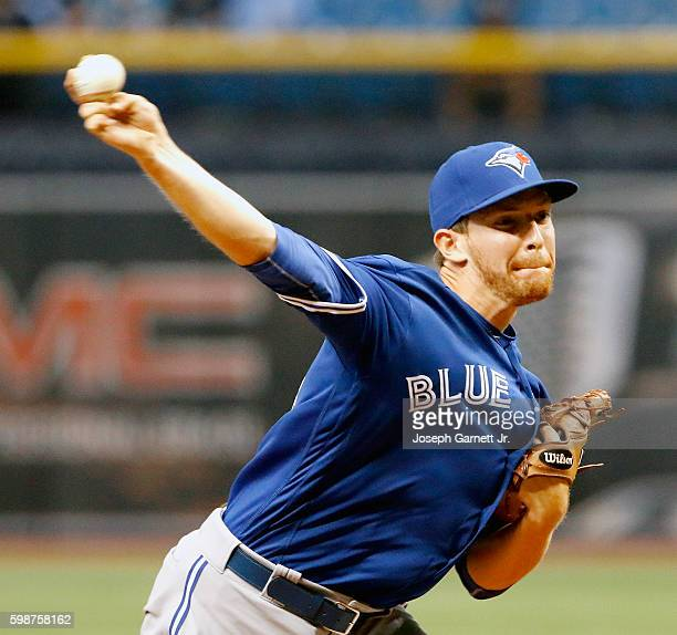 Danny Barnes of the Toronto Blue Jays delivers a pitch during the ninth inning of their game against the Tampa Bay Rays at Tropicana Field on...