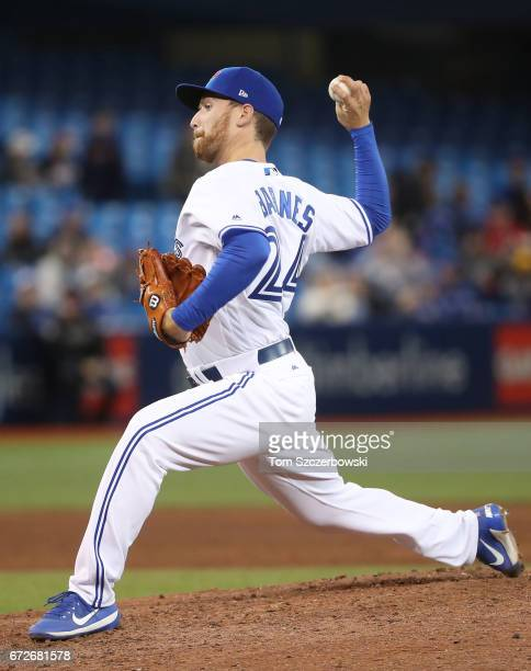 Danny Barnes of the Toronto Blue Jays delivers a pitch in the eighth inning during MLB game action against the Boston Red Sox at Rogers Centre on...