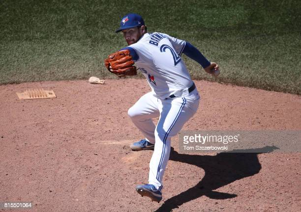 Danny Barnes of the Toronto Blue Jays delivers a pitch in the eighth inning during MLB game action against the Houston Astros at Rogers Centre on...