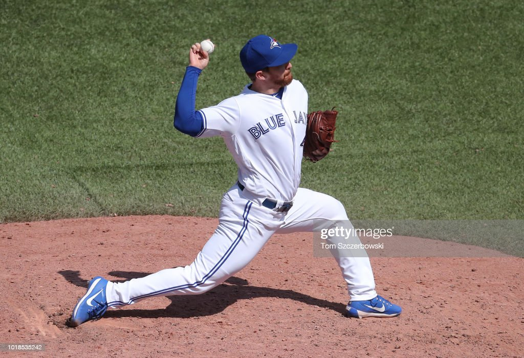 Danny Barnes #24 of the Toronto Blue Jays delivers a pitch in the seventh inning during MLB game action against the Tampa Bay Rays at Rogers Centre on August 12, 2018 in Toronto, Canada.