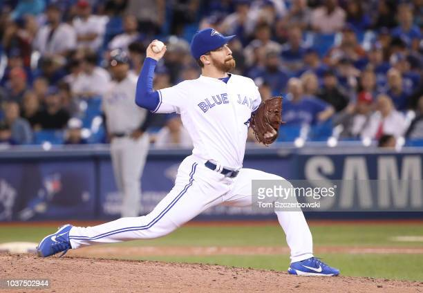 Danny Barnes of the Toronto Blue Jays delivers a pitch in the seventh inning during MLB game action against the Tampa Bay Rays at Rogers Centre on...