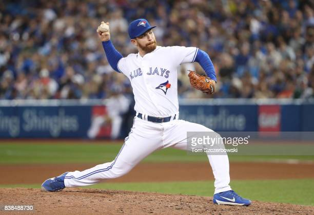 Danny Barnes of the Toronto Blue Jays delivers a pitch in the seventh inning during MLB game action against the New York Yankees at Rogers Centre on...