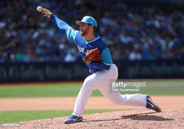 Danny Barnes of the Toronto Blue Jays delivers a pitch in the seventh inning during MLB game action against the Minnesota Twins at Rogers Centre on...