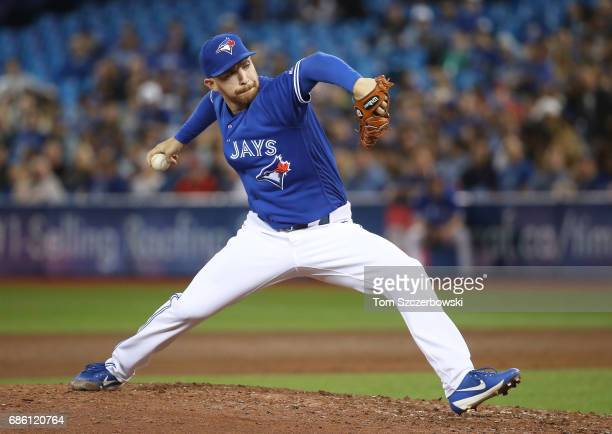 Danny Barnes of the Toronto Blue Jays delivers a pitch in the sixth inning during MLB game action against the Seattle Mariners at Rogers Centre on...