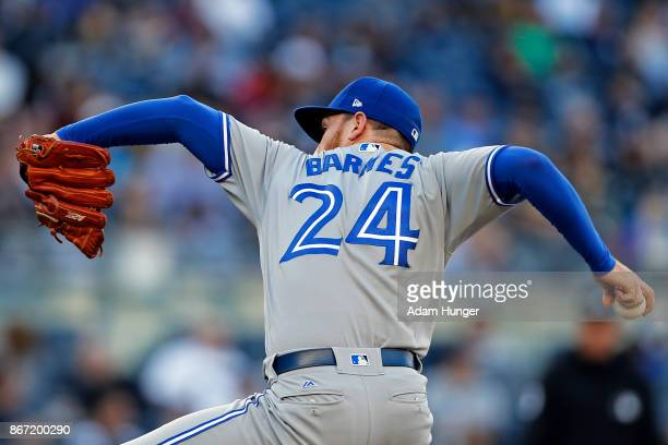 Danny Barnes of the Toronto Blue Jays pitches against the New York Yankees during the seventh inning at Yankee Stadium on October 1 2017 in the Bronx...