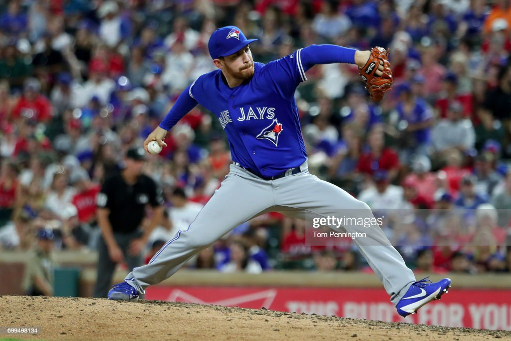 Danny Barnes #24 of the Toronto Blue Jays pitches against the Texas Rangers in the bottom of the seventh inning at Globe Life Park in Arlington on June 21, 2017 in Arlington, Texas.