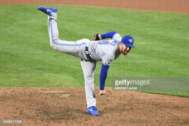 Danny Barnes of the Toronto Blue Jays pitches during a baseball game against the Baltimore Orioles at Oriole Park at Camden Yards on September 19...