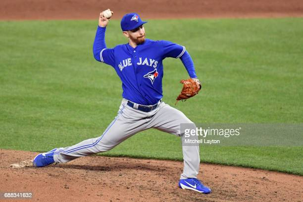 Danny Barnes of the Toronto Blue Jays pitches during a baseball game against the Baltimore Orioles at Oriole Park at Camden Yards on May 20 2017 in...