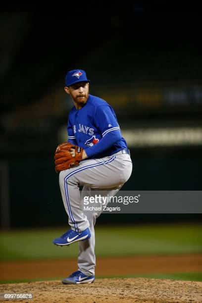Danny Barnes of the Toronto Blue Jays pitches during the game against the Oakland Athletics at the Oakland Alameda Coliseum on June 5 2017 in Oakland...