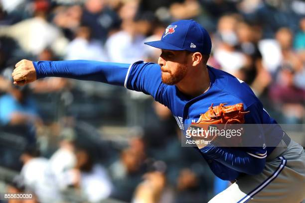 Danny Barnes of the Toronto Blue Jays pitches during the sixth inning against the New York Yankees at Yankee Stadium on September 29 2017 in the...