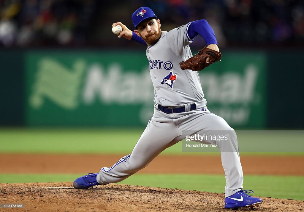 Danny Barnes #24 of the Toronto Blue Jays throws against the Texas Rangers in the fifth inning at Globe Life Park in Arlington on April 7, 2018 in Arlington, Texas.