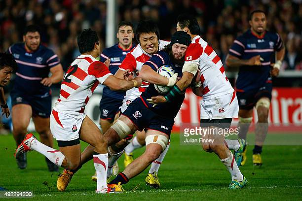Danny Barrett of the United States is wrapped up in the Japan defense during the 2015 Rugby World Cup Pool B match between USA and Japan at Kingsholm...