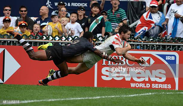 Danny Barrett of USA dives over but try disallowed during day 3 of the match between Fiji and USA 2014 HSBC Hong Kong Sevens at Hong Kong Stadium on...