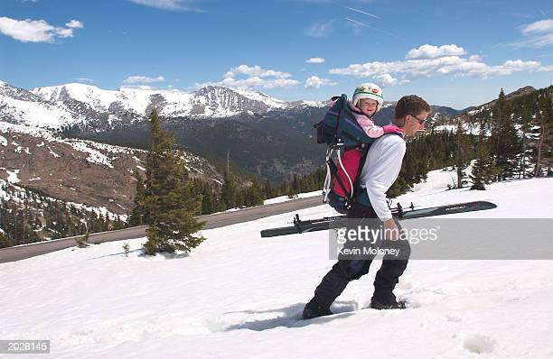 Danny Basch of Estes Park Colorado packs his daughter Annalise for a ski run above Trail Ridge Road May 23 2003 in Rocky Mountain National Park...
