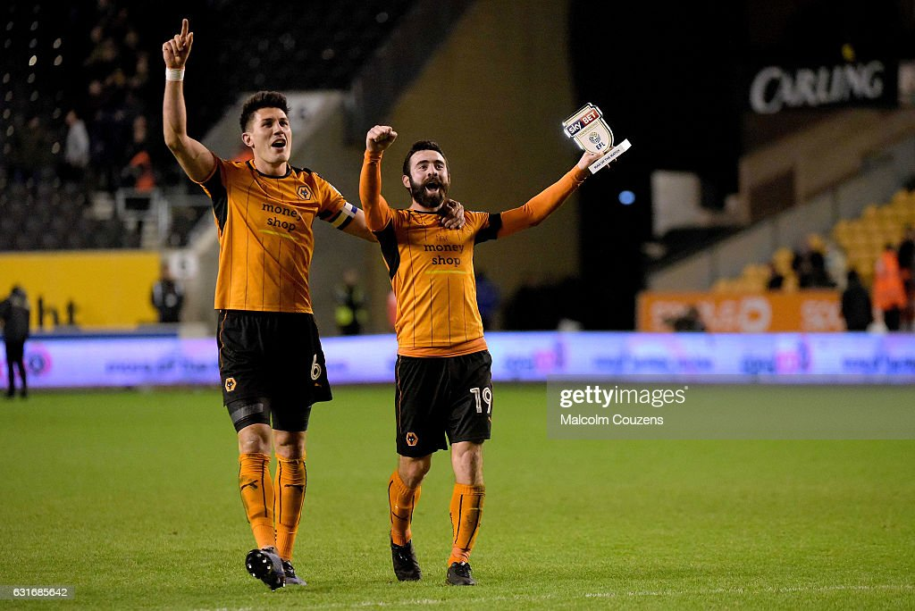 Danny Batth and Jack Price of Wolverhampton Wanderers celebrate following fthe Sky Bet Championship match between Wolverhampton Wanderers and Aston Villa at Molineux on January 14, 2017 in Wolverhampton, England.