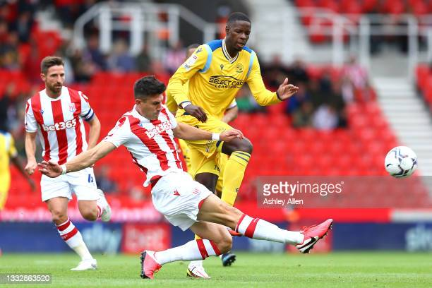 Danny Batth of Stoke City tackles Lucas Joao of Reading FC during the Sky Bet Championship match between Stoke City and Reading at Bet365 Stadium on...