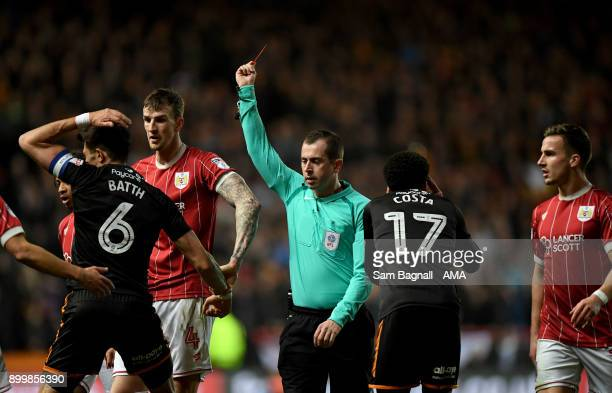 Danny Batth of Wolverhampton Wanderers is shown a red card as he is sent off during the Sky Bet Championship match between Bristol City and...