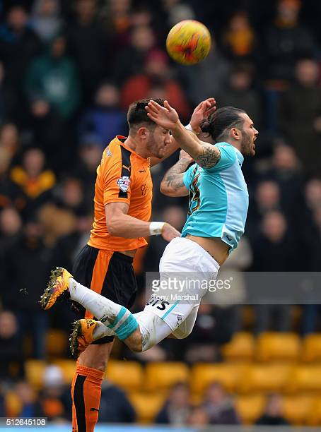 Danny Batth of Wolverhampton Wanderers is tackled by Bradley Johnson of Derby County during the Sky Bet Championship match between Wolverhampton...