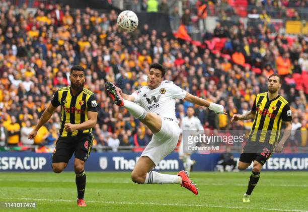 Danny Batth of Wolverhampton Wanderers stretches for the ball ahead of Adrian Mariappa of Watford during the FA Cup Semi Final match between Watford...