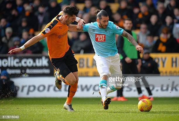 Danny Batth of Wolverhampton Wanderers tackles Bradley Johnson of Derby County during the Sky Bet Championship match between Wolverhampton Wanderers...