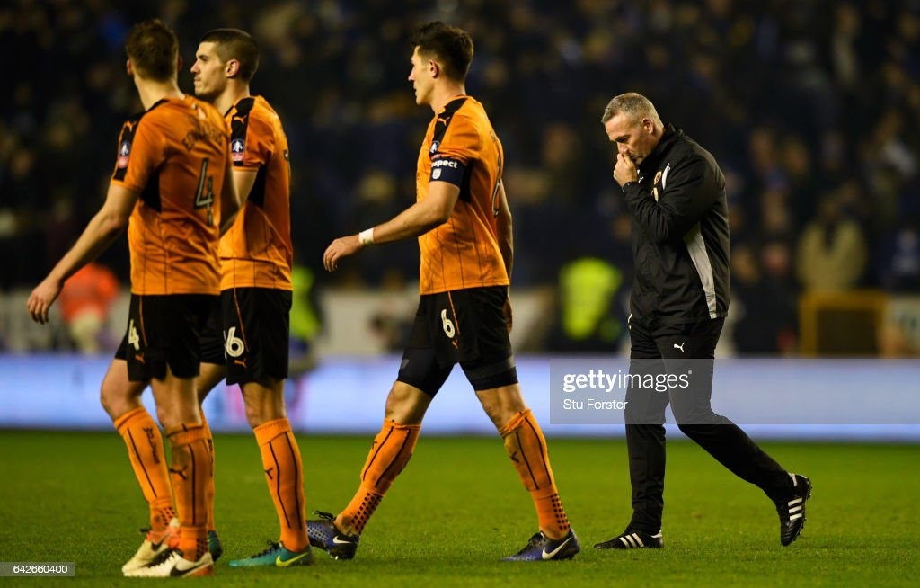 Danny Batth of Wolves (C) and Paul Lambert, manager of Wolves (R) walk off the pitch dejected after The Emirates FA Cup Fifth Round match between Wolverhampton Wanderers and Chelsea at Molineux on February 18, 2017 in Wolverhampton, England.