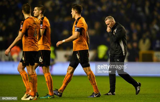 Danny Batth of Wolves and Paul Lambert manager of Wolves walk off the pitch dejected after The Emirates FA Cup Fifth Round match between...