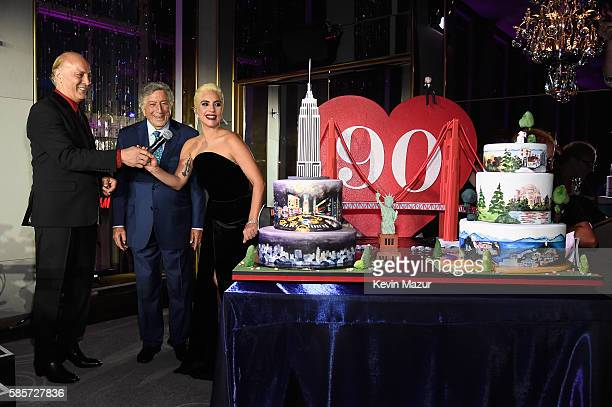 Danny Bennett and Lady Gaga present Tony Bennett with his 90th birthday cake at The Rainbow Room on August 3 2016 in New York City