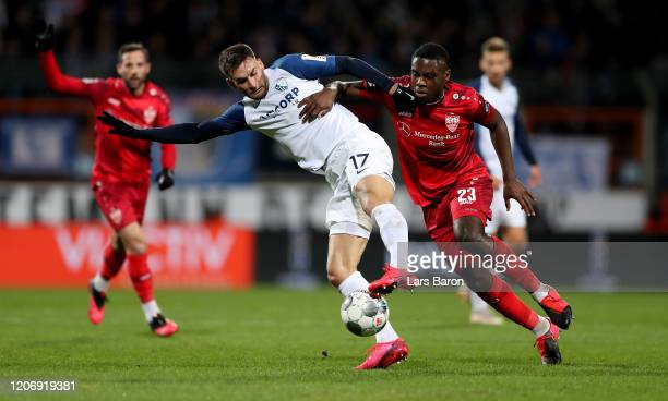 Danny Blum of Bochum is challenged by Orel Mangala of Stuttgart during the Second Bundesliga match between VfL Bochum 1848 and VfB Stuttgart at...