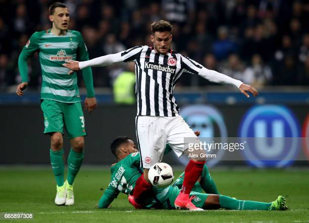 Danny Blum of Frankfurt and Theodor Gebre Selassie of Bremen battle for the ball during the Bundesliga match between Eintracht Frankfurt and Werder...