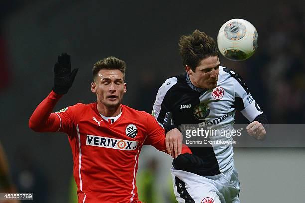Danny Blum of SV Sandhausen and Pirmin Schwegler of Eintracht Frankfurt battle for the ball during the DFB Cup match between Eintracht Frankfurt and...