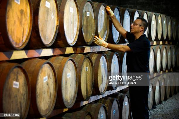 Danny Borzacciello stores a barrel at the Auchentoshan Distillery a Single Malt whisky distillery on the outskirts of Glasgow on December 12 2016...
