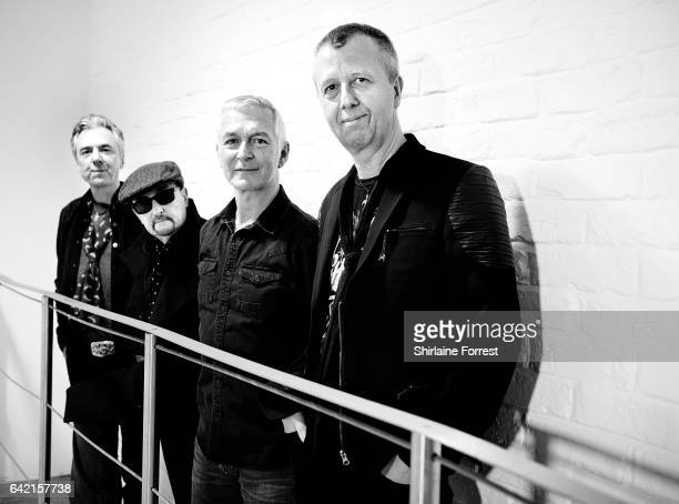 Danny Bowes, Ben Matthews, Chris Childs and Harry James of Thunder pose backstage after performing live and signing copies of their new album 'Rip it...