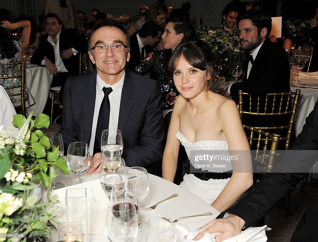Danny Boyle (L) and Felicity Jones attend a drinks reception at the 58th London Evening Standard Theatre Awards in association with Burberry at The Savoy Hotel on November 25, 2012 in London, England.