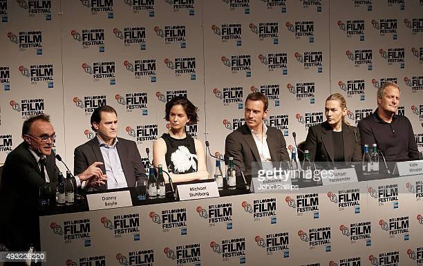 Danny Boyle Michael Stuhlbarg Katherine Waterston Michael Fassbender Kate Winslet and Jeff Daniels attend the Steve Jobs Press Conference during the...