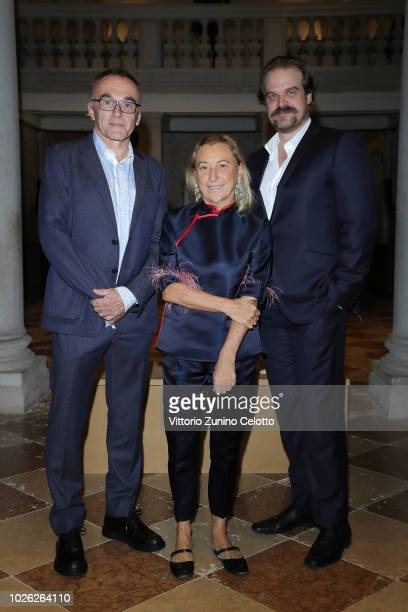 Danny Boyle, Miuccia Prada and David Harbour attend Miu Miu Women's Tales Dinner during Venice Film Festival on September 2, 2018 in Venice, Italy.