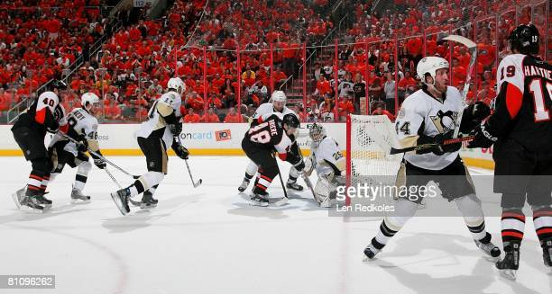 Danny Briere along with teammates Vaclav Prospal and Scott Hartnell of the Philadelphia Flyers take a shot on goal against Tyler Kennedy, Jordan...