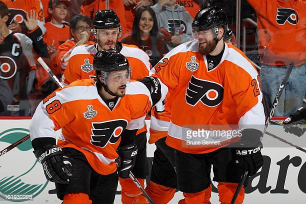 Danny Briere and Ville Leino of the Philadelphia Flyers celebrate Briere's goal in the second period against the Chicago Blackhawks in Game Six of...