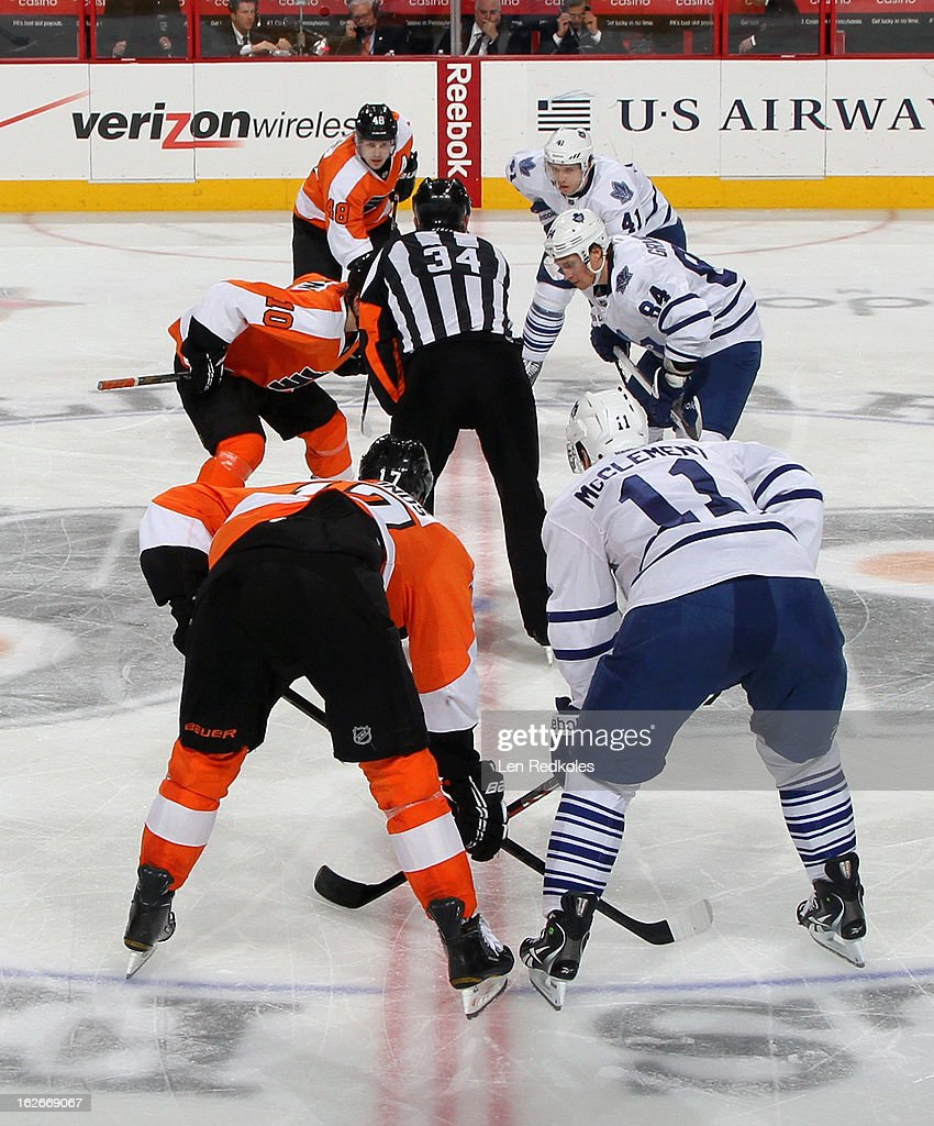 Danny Briere #48, Brayden Schenn #10, and Wayne Simmonds #17 of the Philadelphia Flyers line up to face-off with Nikolai Kulemin #41, Mikhail Grabovski #84, and Jay McClement #11 of the Toronto Maple Leafs on February 25, 2013 at the Wells Fargo Center in Philadelphia, Pennsylvania. The Maple Leafs went on to defeat the Flyers 4-2.