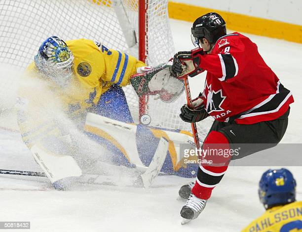 Danny Briere of Canada attempts to score against goalie Henrik Lundqvist of Sweden in the teams' match at the International Ice Hockey Federation...