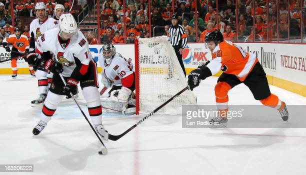 Danny Briere of the Philadelphia Flyers battles for the puck against Peter Regin of the Ottawa Senators on March 2, 2013 at the Wells Fargo Center in...