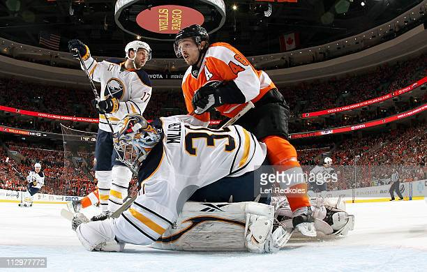 Danny Briere of the Philadelphia Flyers interferes with goaltender Ryan Miller of the Buffalo Sabres earning a penalty in Game Five of the Eastern...