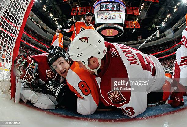 Danny Briere of the Philadelphia Flyers is involved in a scrum on the goal line against Derek Morris and Ilya Bryzgalov of the Phoenix Coyotes on...